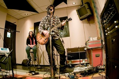 A band performs live on the air at KEXP