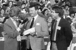 Pat Fahey, then President of title sponsor US Bank (center) and Steve Lawson (right) present a check to Children's Hospital to KOMO TV's Kathi Goertzen during the 1987 Children's Hospital Telethon.