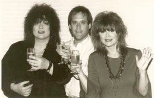 Ann Wilson (left), Steve Lawson (middle), Nancy Wilson (right) celebrate the opening of Bad Animals/Seattle